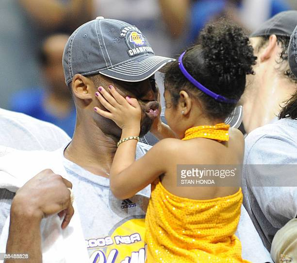 Kobe Bryant of the Los Angeles Lakers celebrates victory with his daughter following Game 5 of the NBA Finals against the Orlando Magic at Amway...