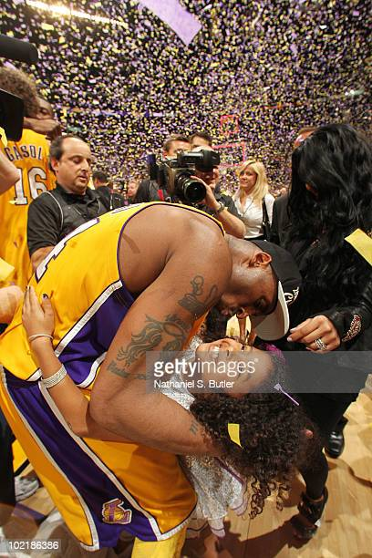 Kobe Bryant of the Los Angeles Lakers celebrates with his daughter after winning over the Boston Celtics in Game Seven of the 2010 NBA Finals on June...