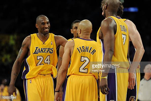 Kobe Bryant of the Los Angeles Lakers celebrates with teammates during a break in action against the Phoenix Suns in the fourth quarter of Game Two...