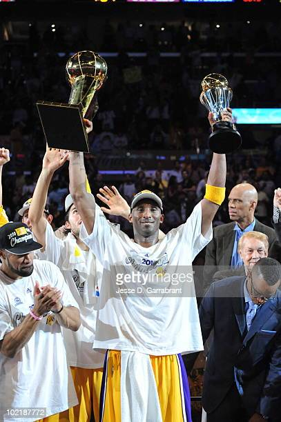 Kobe Bryant of the Los Angeles Lakers celebrates with the Larry O'Brien and Bill Russell Finals MVP Trophies after defeating the Boston Celtics 8379...