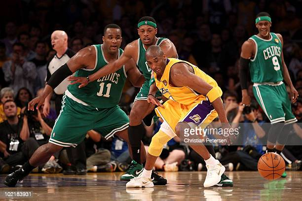 Kobe Bryant of the Los Angeles Lakers chases after a loose ball ahead of Glen Davis and Paul Pierce of the Boston Celtics in Game Seven of the 2010...