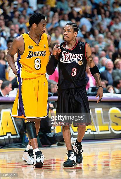 Kobe Bryant of the Los Angeles Lakers chats with Allen Iverson of the Philadelphia 76ers during game one of the 2001 NBA Finals played on June 6 2001...