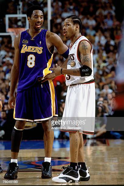 Kobe Bryant of the Los Angeles Lakers chats with Allen Iverson of the Philadelphia 76ers during a 2001 NBA game at the First Union Center in...