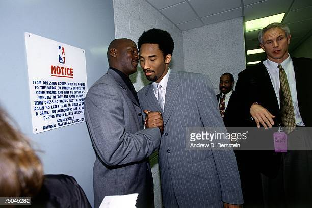 Kobe Bryant of the Los Angeles Lakers chats with Michael Jordan of the Chicago Bulls after a 2000 NBA game at the Staples Center in Los Angeles...