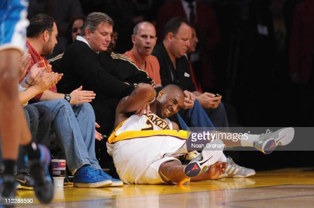 Kobe Bryant of the Los Angeles Lakers collects himself after falling into a row of courtside seats against the New Orleans Hornets in Game One of the...