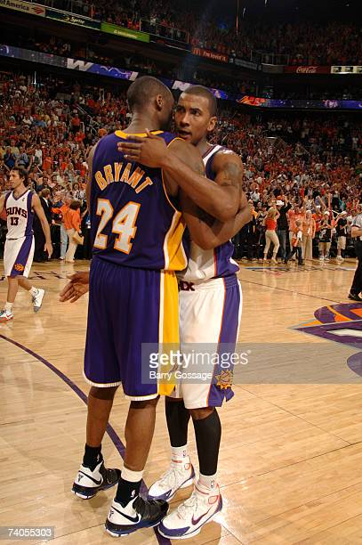 Kobe Bryant of the Los Angeles Lakers congratulates Raja Bell of the Phoenix Suns after the Suns defeat the Lakers 119110 and win the best of seven...