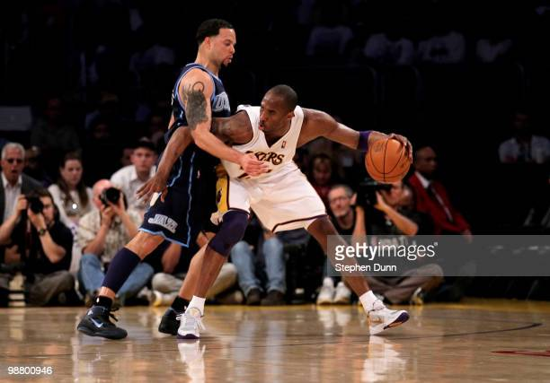 Kobe Bryant of the Los Angeles Lakers controls the ball against Deron Williams of the Utah Jazz during Game One of the Western Conference Semifinals...