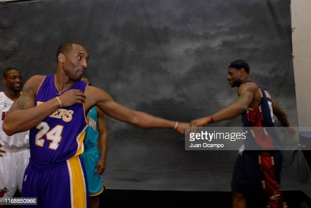 Kobe Bryant of the Los Angeles Lakers daps up LeBron James of the Cleveland Cavaliers before the Sprite Slam Dunk Competition at NBA All-Star Weekend...