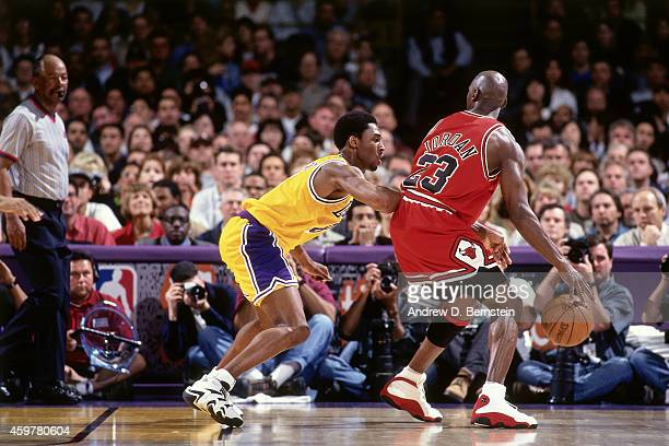 Kobe Bryant of the Los Angeles Lakers defends against Michael Jordan of the Chicago Bulls on February 1 1998 at The Forum in Inglewood California...
