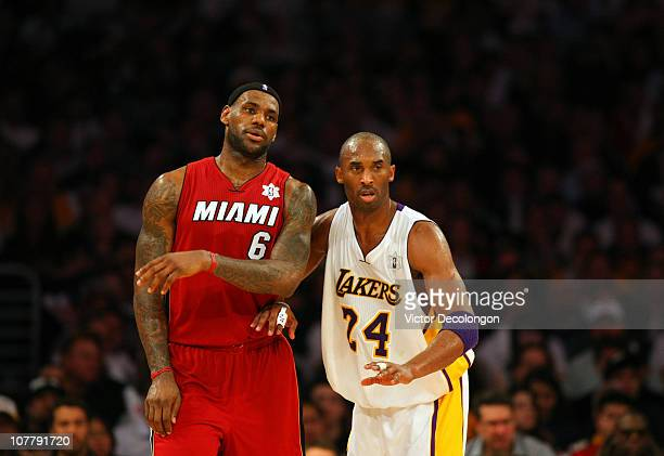 Kobe Bryant of the Los Angeles Lakers defends LeBron James of the Miami Heat during the NBA game at Staples Center on December 25 2010 in Los Angeles...