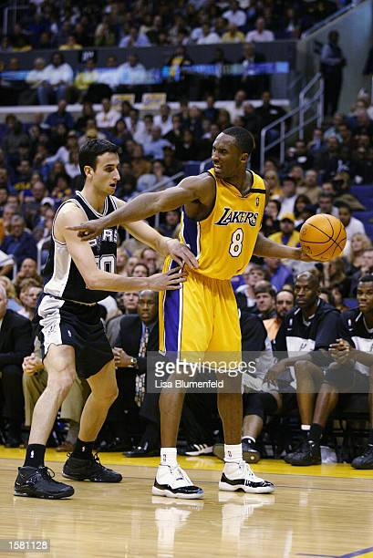 Kobe Bryant of the Los Angeles Lakers directs the play while under pressure from Emanuel Ginobili of the San Antonio Spurs during the game on October...