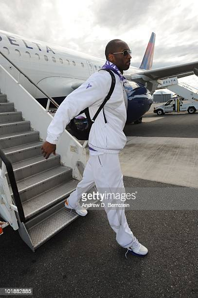 Kobe Bryant of the Los Angeles Lakers disembarks the team plane to Boston for Game Three of the 2010 NBA Finals against the Boston Celtics on June 7...