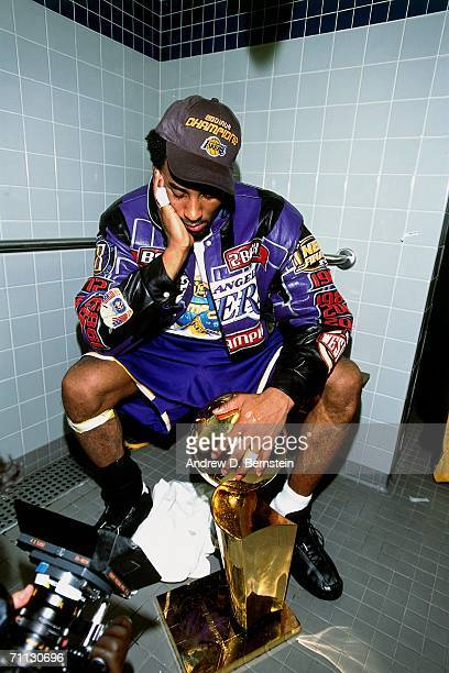 Kobe Bryant of the Los Angeles Lakers displaying the NBA championship trophy after defeating the Philadelphia 76ers in game five of the 2001 NBA...