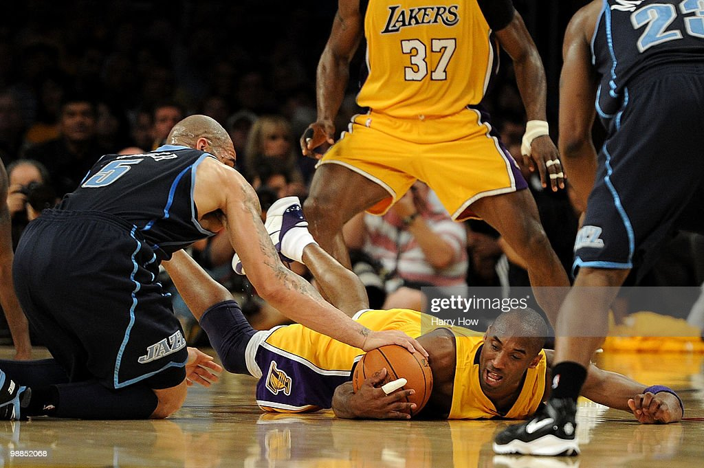 Kobe Bryant #24 of the Los Angeles Lakers dives for a loose ball against Carlos Boozer #5 of the Utah Jazz in the first half during Game Two of the Western Conference Semifinals of the 2010 NBA Playoffs at Staples Center on May 4, 2010 in Los Angeles, California.