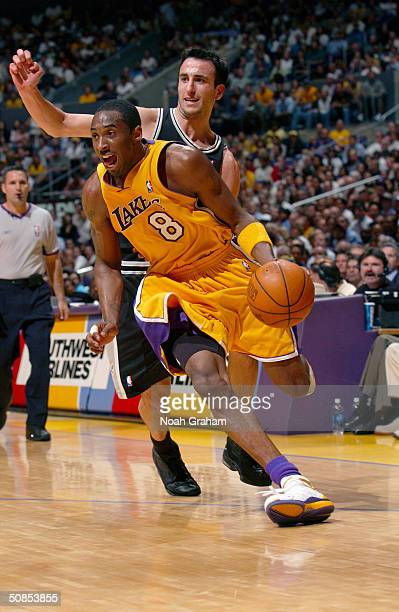 Kobe Bryant of the Los Angeles Lakers dribble drives to the basket past Emanuel Ginobili of the San Antonio Spurs in Game Four of the Western...