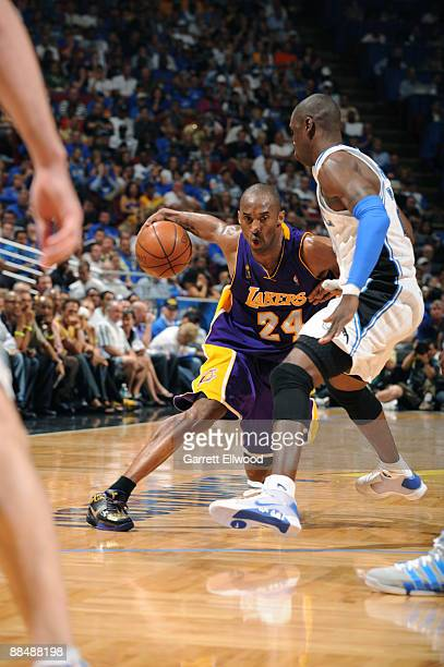 Kobe Bryant of the Los Angeles Lakers dribbles against Mickael Pietrus of the Orlando Magic in Game Five of the 2009 NBA Finals at Amway Arena on...
