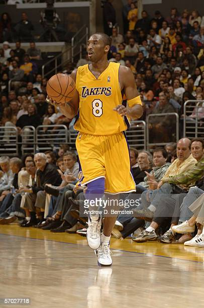 Kobe Bryant of the Los Angeles Lakers dribbles against the Memphis Grizzlies during the game at Staples Center on February 11 2006 in Los Angeles...