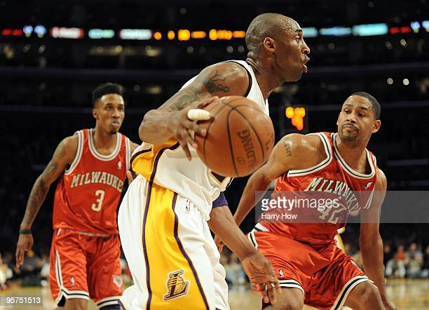 0ab0180a9f3 Kobe Bryant of the Los Angeles Lakers dribbles around Charlie Bell and Brandon  Jennings of the. Milwaukee Bucks v ...