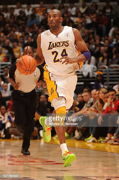 Kobe Bryant of the Los Angeles Lakers dribbles during a game against the Miami Heat at Staples Center on December 25 2010 in Los Angeles California...