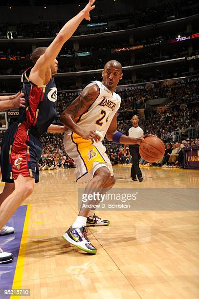Kobe Bryant of the Los Angeles Lakers dribbles during a game against the Cleveland Cavaliers at Staples Center on December 25 2009 in Los Angeles...