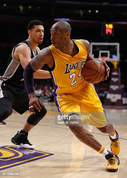 Kobe Bryant of the Los Angeles Lakers dribbles past Danny Green of the San Antonio Spurs during the second half of a game at Staples Center on...