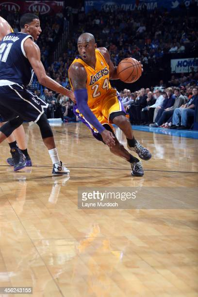 Kobe Bryant of the Los Angeles Lakers dribbles the ball against the Oklahoma City Thunder on December 13 2013 at the Chesapeake Energy Arena in...
