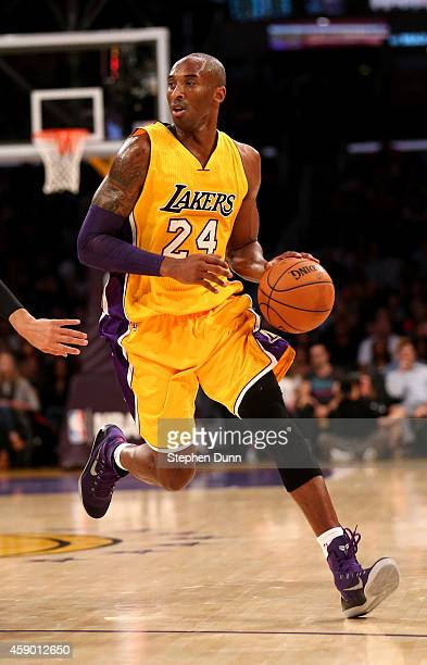 Kobe Bryant of the Los Angeles Lakers dribbles the ball against the San Antonio Spurs at Staples Center on November 14 2014 in Los Angeles California...