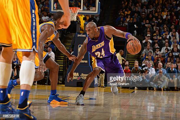 Kobe Bryant of the Los Angeles Lakers dribbles the ball against the Golden State Warriors on November 24 2015 at ORACLE Arena in Oakland California...