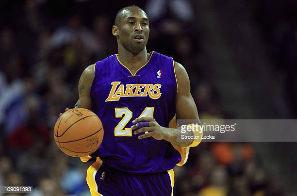 Kobe Bryant of the Los Angeles Lakers dribbles the ball up the court against the Charlotte Bobcats during their game at Time Warner Cable Arena on...