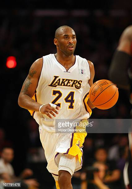 Kobe Bryant of the Los Angeles Lakers dribbles the ball upcourt against the Miami Heat during the NBA game at Staples Center on December 25 2010 in...