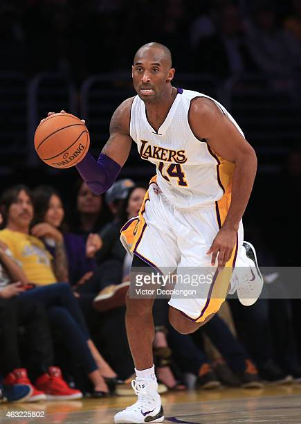 Kobe Bryant of the Los Angeles Lakers dribbles the ball upcourt during the NBA game against the Charlotte Hornets at Staples Center on November 9...