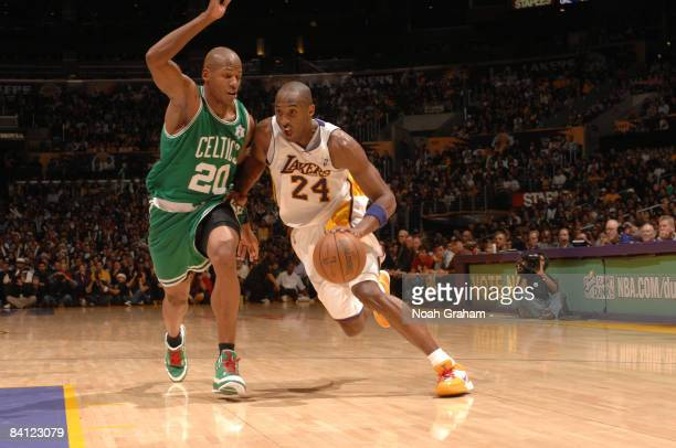 Kobe Bryant of the Los Angeles Lakers dribbles to the basket against Ray Allen of the Boston Celtics at Staples Center on December 25 2008 in Los...