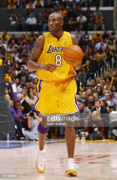 Kobe Bryant of the Los Angeles Lakers dribbles upcourt against the Denver Nuggets on November 2 2004 at Staples Center in Los Angeles California The...