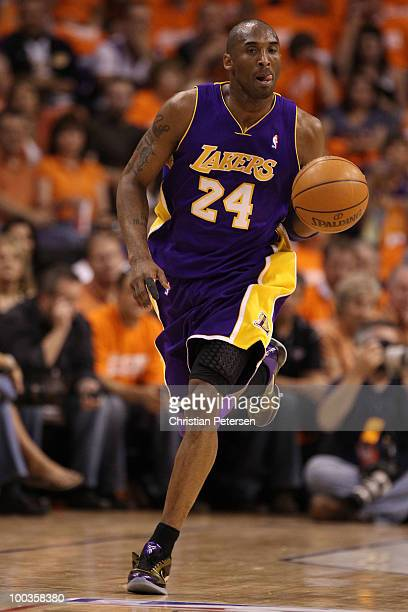 Kobe Bryant of the Los Angeles Lakers dribbles with the ball against the Phoenix Suns in the first half of Game Three of the Western Conference...