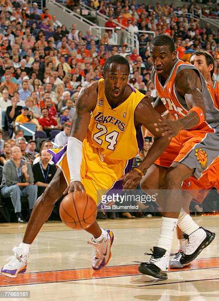 Kobe Bryant of the Los Angeles Lakers drives against Amare Stoudemire of the Phoenix Suns at US Airways Center on November 2 2007 in Phoenix Arizona...