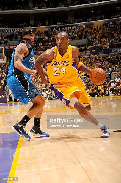 Kobe Bryant of the Los Angeles Lakers drives against Courtney Lee of the Orlando Magic during Game One of the 2009 NBA Finals at Staples Center on...