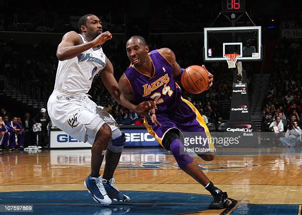 Kobe Bryant of the Los Angeles Lakers drives against Gilbert Arenas of the Washington Wizards at the Verizon Center on December 14 2010 in Washington...