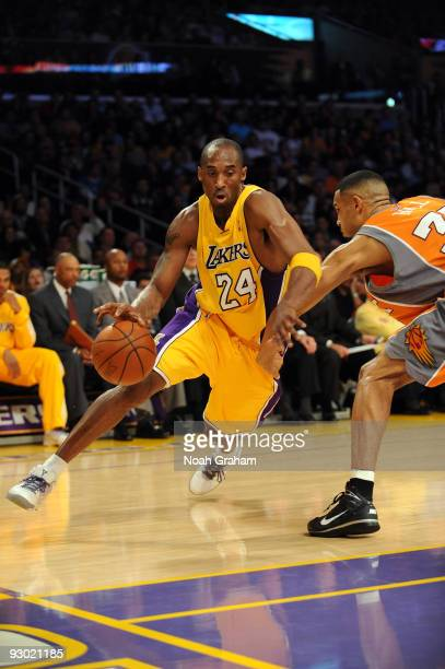 Kobe Bryant of the Los Angeles Lakers drives against Grant Hill of the Phoenix Suns at Staples Center on November 12 2009 in Los Angeles California...
