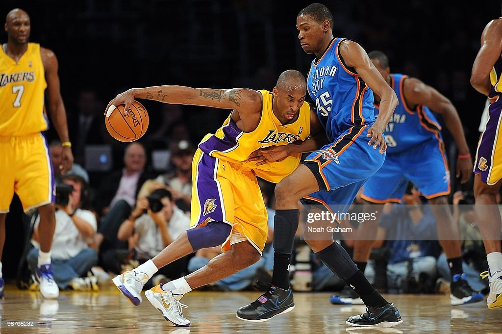 4a50ecf2d3e9 Kobe Bryant of the Los Angeles Lakers drives against Kevin Durant of ...