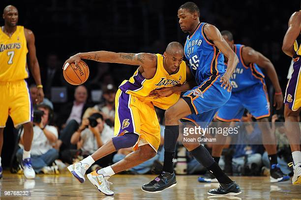 Kobe Bryant of the Los Angeles Lakers drives against Kevin Durant of the Oklahoma City Thunder in Game Five of the Western Conference Quarterfinals...