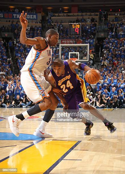 Kobe Bryant of the Los Angeles Lakers drives against Kevin Durant the Oklahoma City Thunder in Game Three of the Western Conference Quarterfinals...
