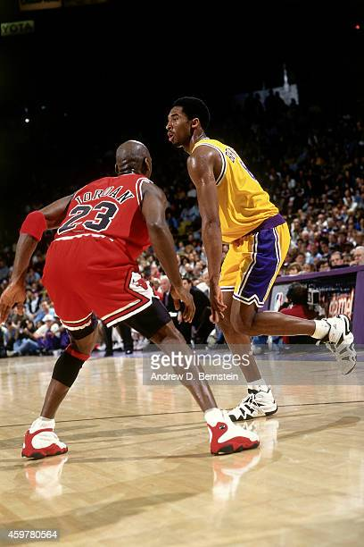 Kobe Bryant of the Los Angeles Lakers drives against Michael Jordan of the Chicago Bulls on February 1 1998 at The Forum in Inglewood California NOTE...