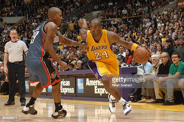 Kobe Bryant of the Los Angeles Lakers drives against Raja Bell of the Charlotte Bobcats at Staples Center on January 27 2009 in Los Angeles...