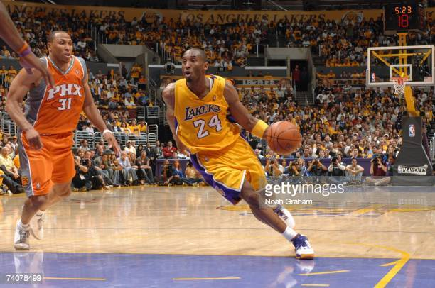 Kobe Bryant of the Los Angeles Lakers drives against Shawn Marion of the Phoenix Suns in Game Three of the Western Conference Quarterfinals during...