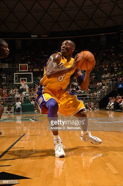 Kobe Bryant of the Los Angeles Lakers drives against the Golden State Warriors during a preseason game October 11, 2005 at Stan Sheriff Center in...