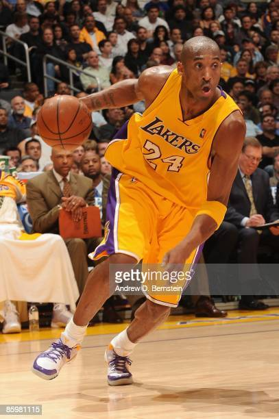 Kobe Bryant of the Los Angeles Lakers drives against the Houston Rockets during the game on April 3, 2009 at Staples Center in Los Angeles,...