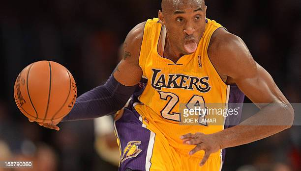 Kobe Bryant of the Los Angeles Lakers drives against the Portland Trail Blazers during their NBA game on December 28 2012 at Staples Center in Los...