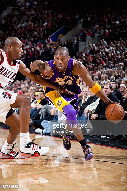 Kobe Bryant of the Los Angeles Lakers drives against Travis Outlaw of the Portland Trail Blazers during the game on April 10 2009 at the Rose Garden...