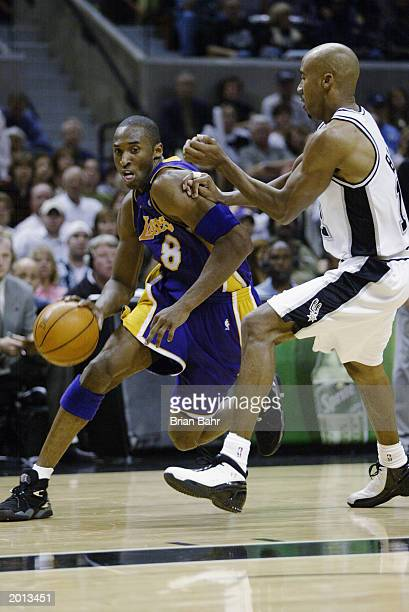 Kobe Bryant of the Los Angeles Lakers drives around Bruce Bowen of the San Antonio Spurs in Game five of the Western Conference Semifinals during the...