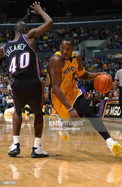 Kobe Bryant of the Los Angeles Lakers drives around Calbert Cheaney of the Utah Jazz during a game at Staples Center on December 8, 2002 in Los...